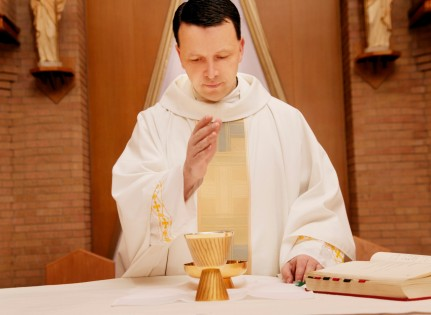 Priest Praying Over Communion